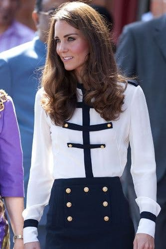 db27d3af32 On a visit to Birmingham to meet with local residents affected by the riots  August, Kate wore another Alexander McQueen ensemble, this time a  military-style ...