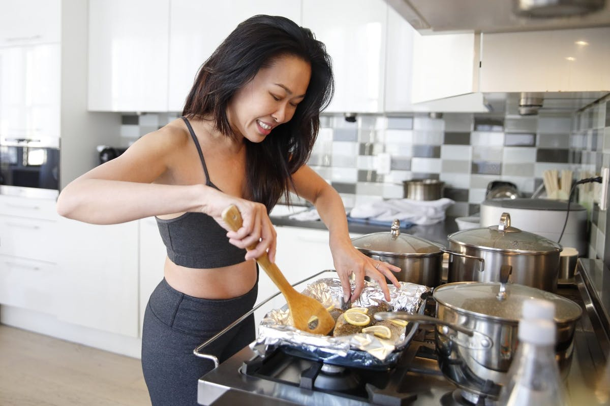Woman cooking after exercise