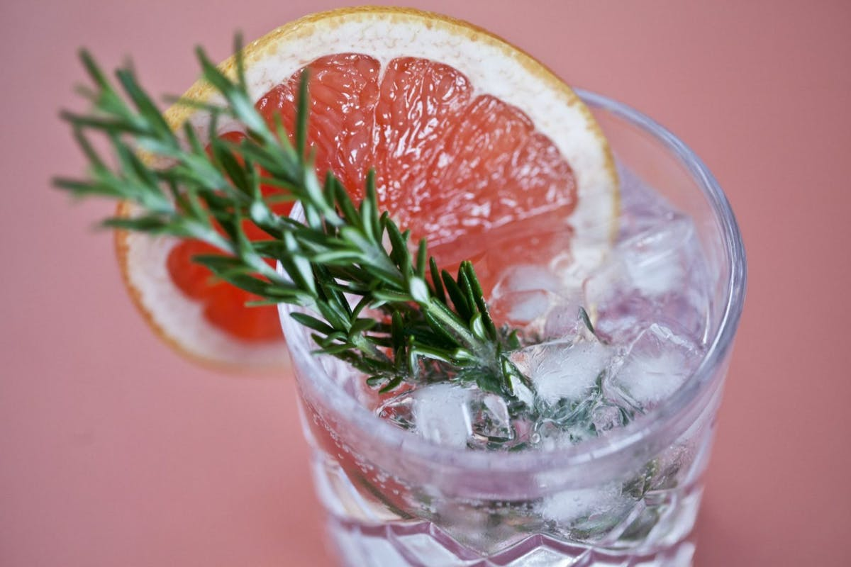 Gin with grapefruit in crystal glass