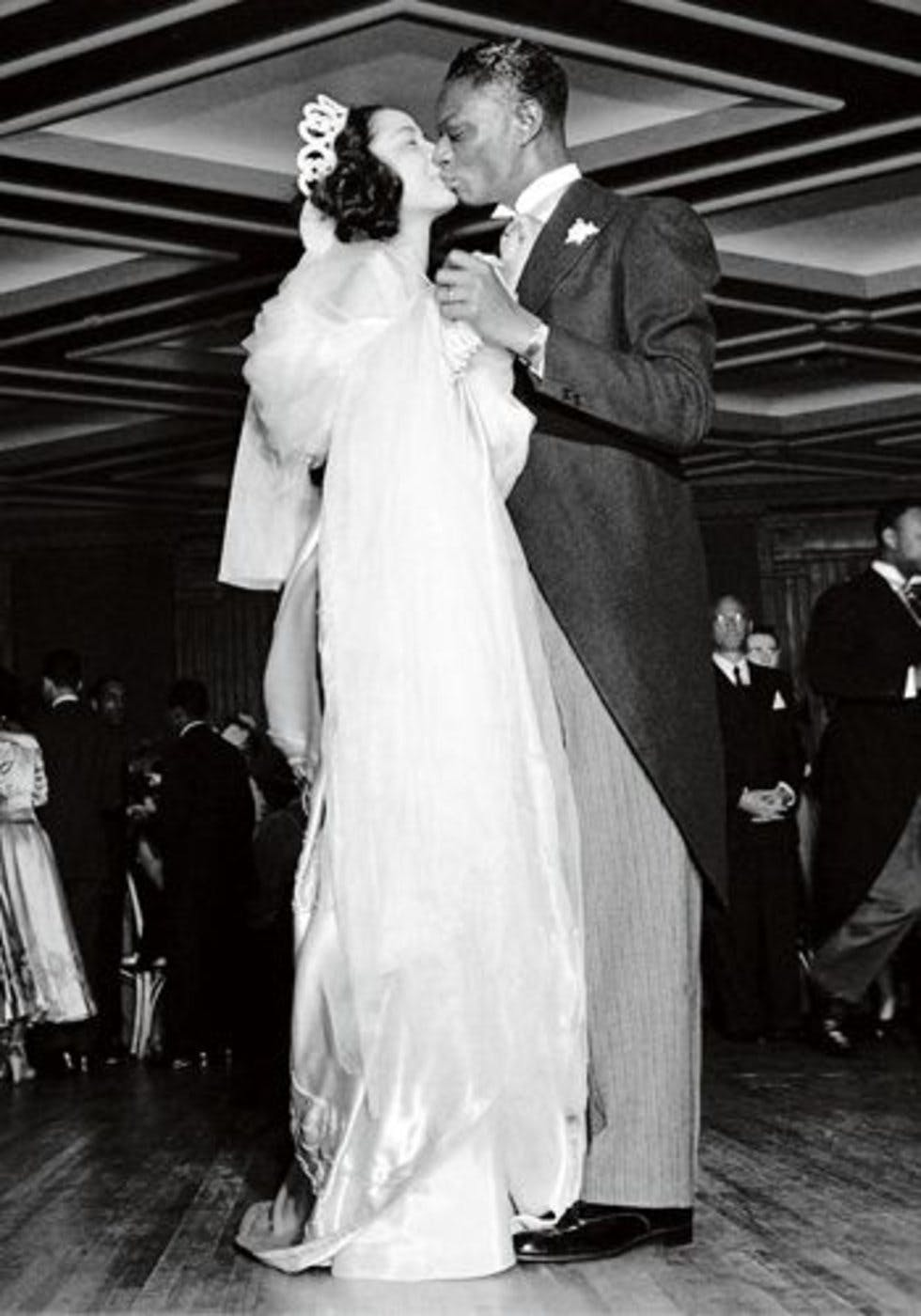 c1c3cc7dd53c American jazz singers Nat King Cole and Maria Ellington share a kiss while  dancing at their wedding reception in Harlem, New York on 28 March 1948.
