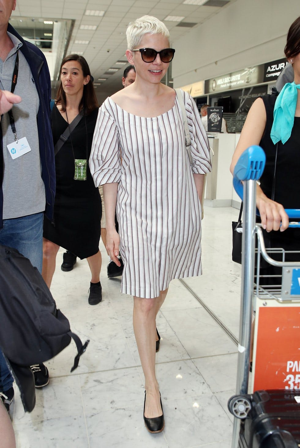 62a98f501821 A simple striped dress is a spring to summer wardrobe staple. It looks  equally chic worn with black ballet pumps and oversized sunnies for the  city, ...