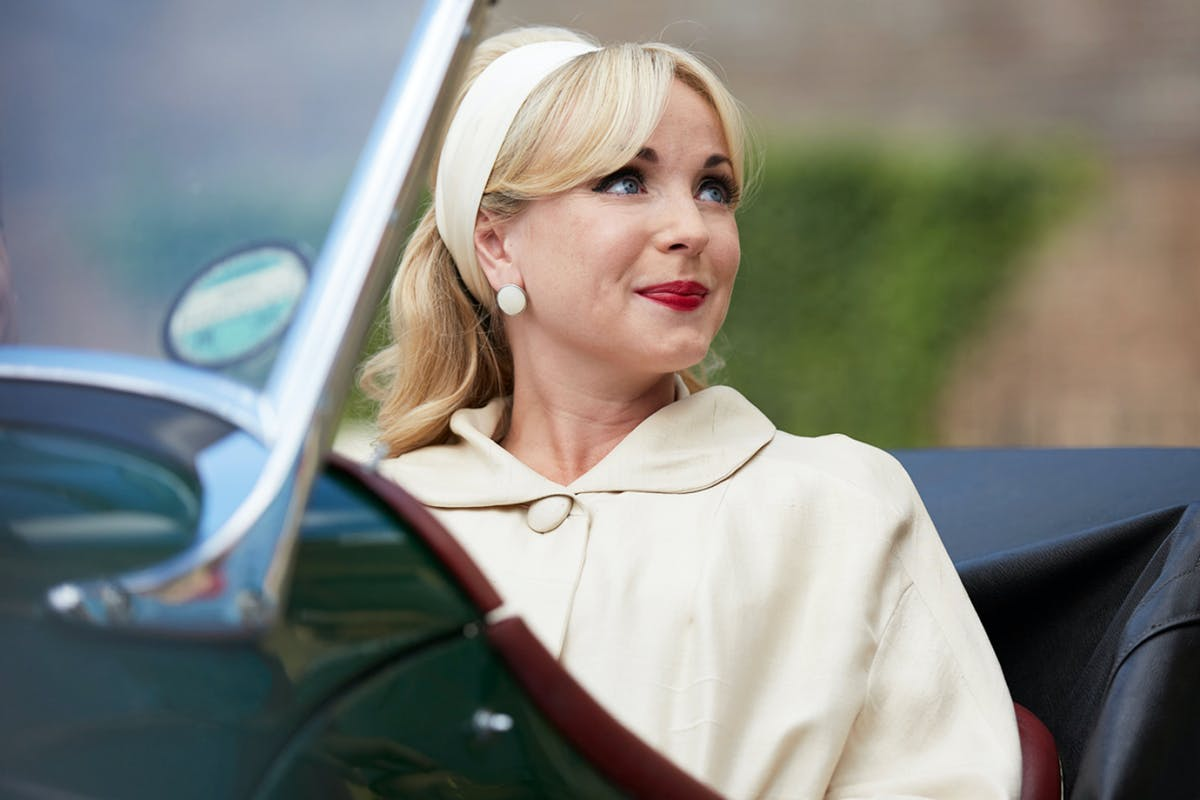 Call the Midwife Helen George in a cream coat and headband