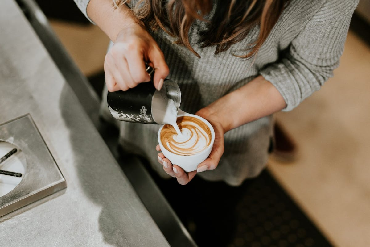 A barista pouring coffee