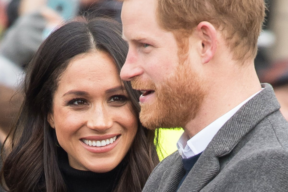 Meghan Markle smiles at Prince Harry