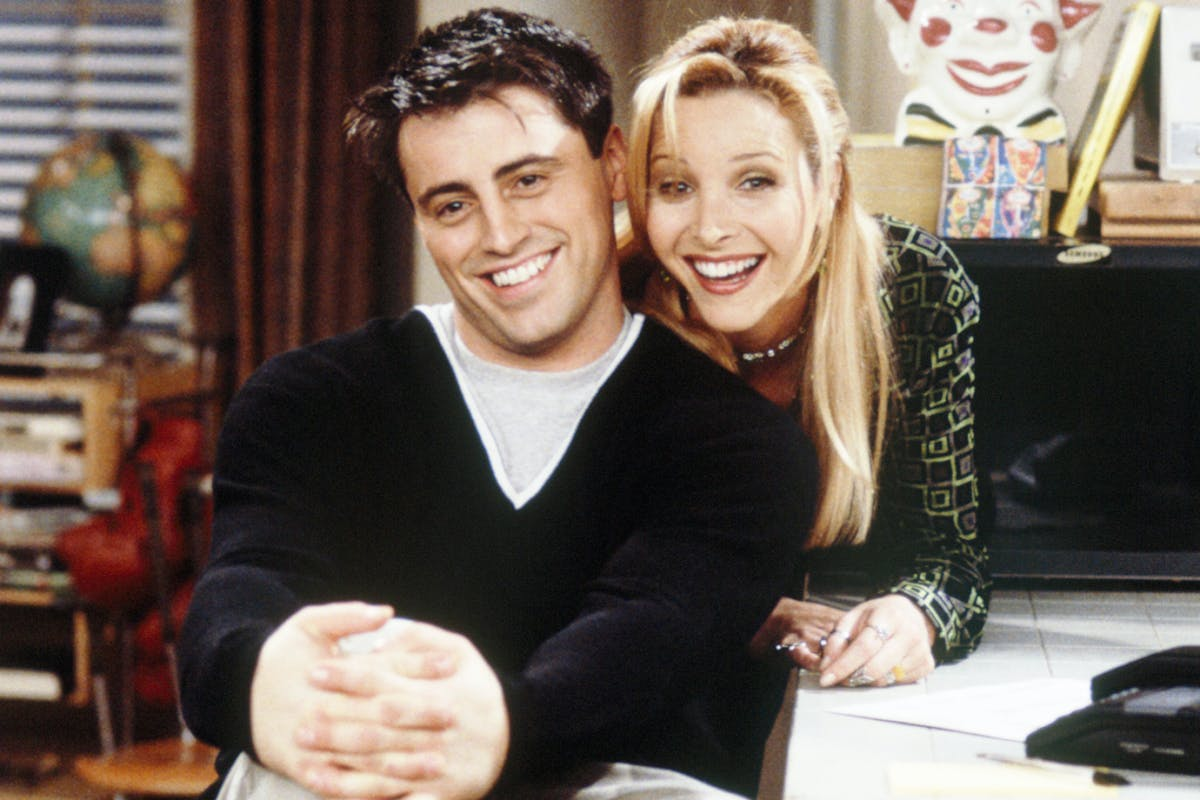 Matt LeBlanc and Lisa Kudrow hugging on the set of Friends