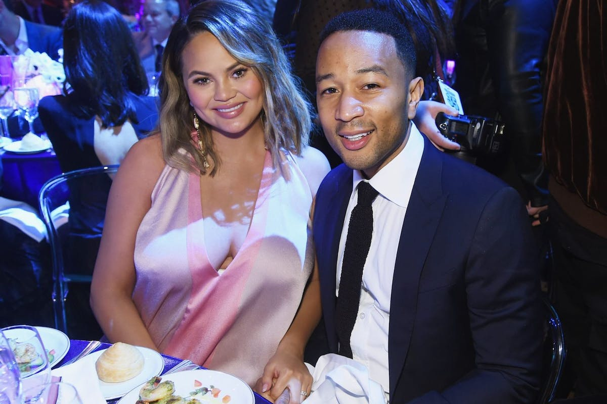 NEW YORK, NY - APRIL 24: Chrissy Teigen (L) and John Legend attend City Harvest's 35th Anniversary Gala at Cipriani 42nd Street on April 24, 2018 in New York City. (Photo by Jamie McCarthy/Getty Images for City Harvest)