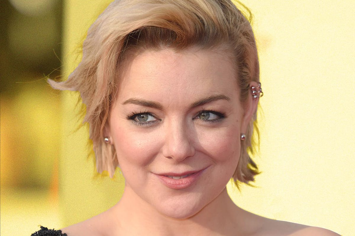 Sheridan Smith with short hair against a yellow background