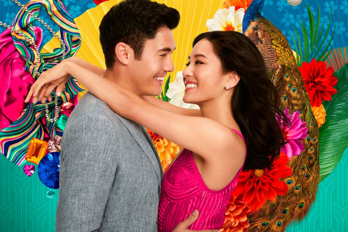 Henry Golding and Constance Wu embrace in the poster for Crazy Rich Asians
