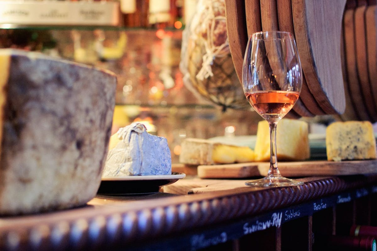 Wine and cheese on counter of cafe in Paris, France.