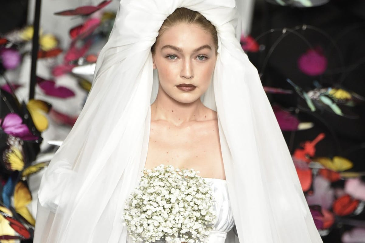 Gigi Hadid shows off ethereal wedding dress 'carried by butterflies'