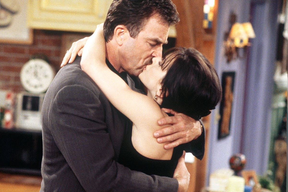 Tom Selleck as Richard and Courteney Cox as Monica kissing in Friends