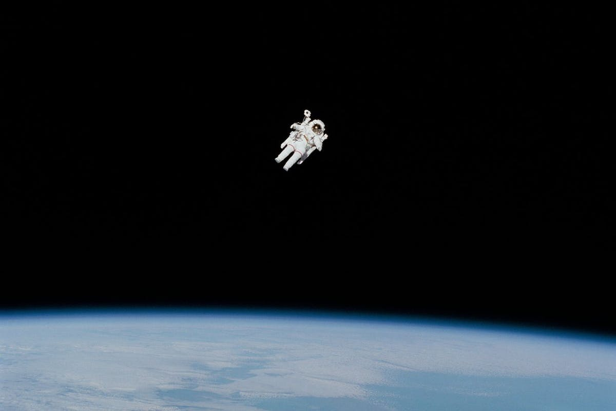 An astronaut suspended in space
