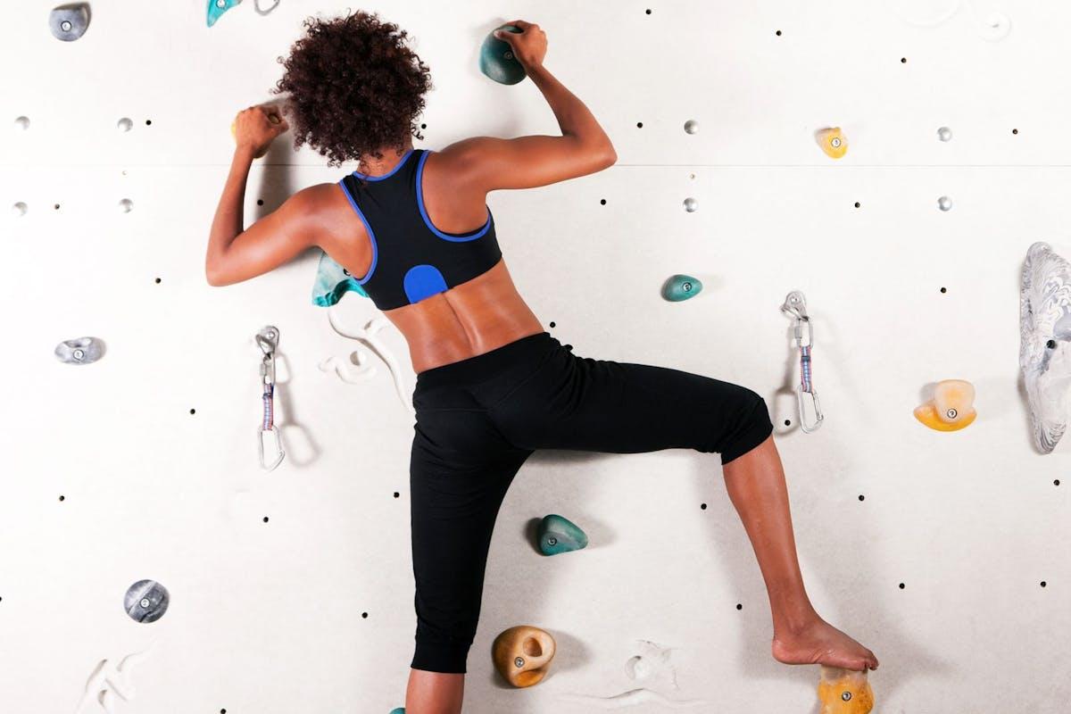 Woman rock-climbing on an indoor wall