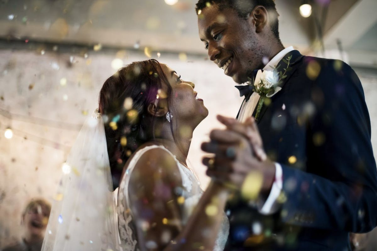 Newlywed african descent couple dancing wedding celebration - stock photo