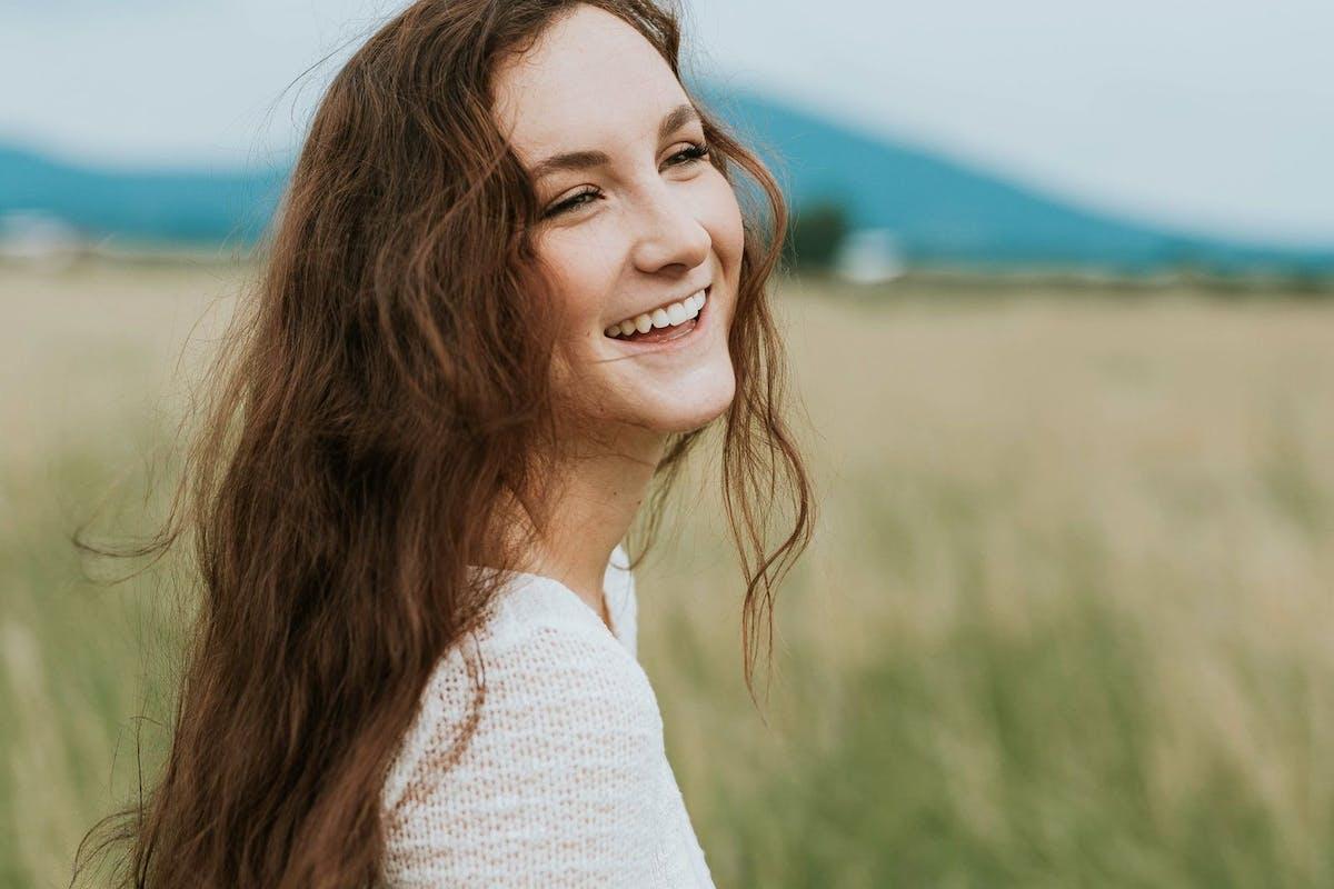 A happy woman in a field