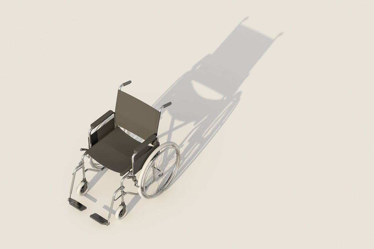 Bird's eye view of a wheelchair casting a shadow