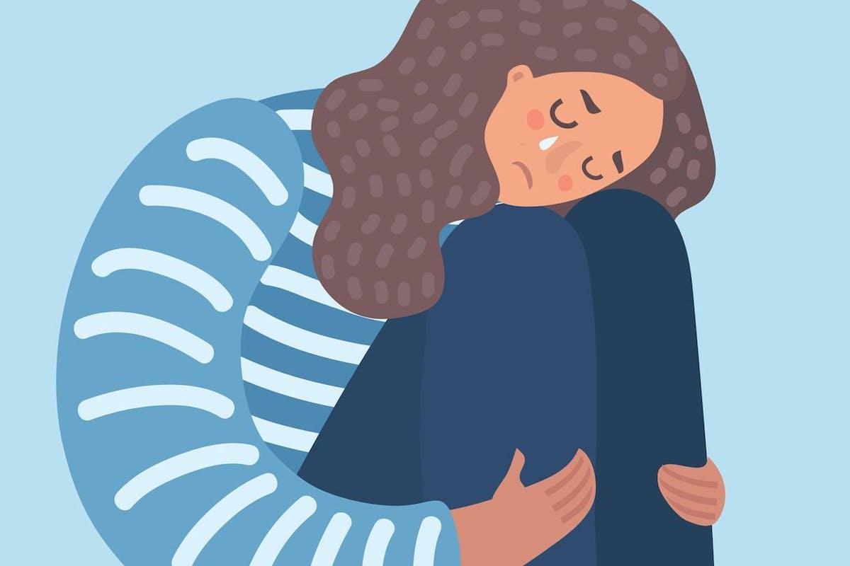 Ilustration of a sad woman hugging her knees.