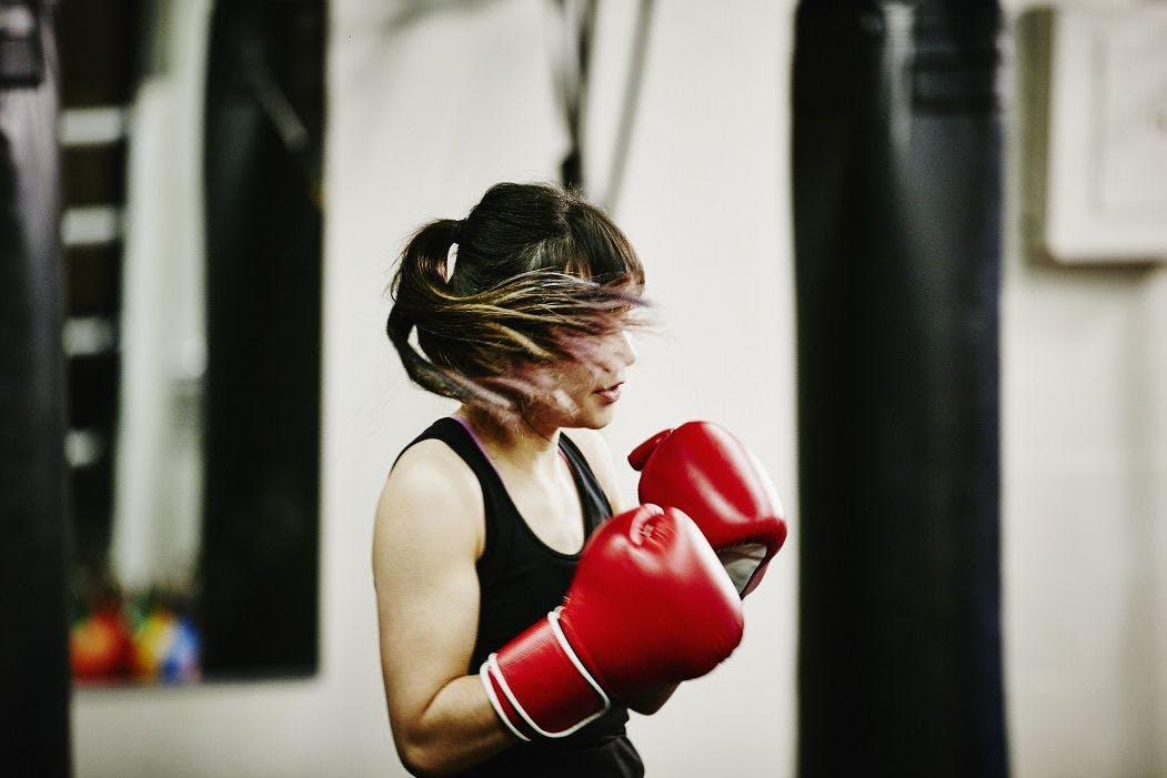 A female kickboxer in training