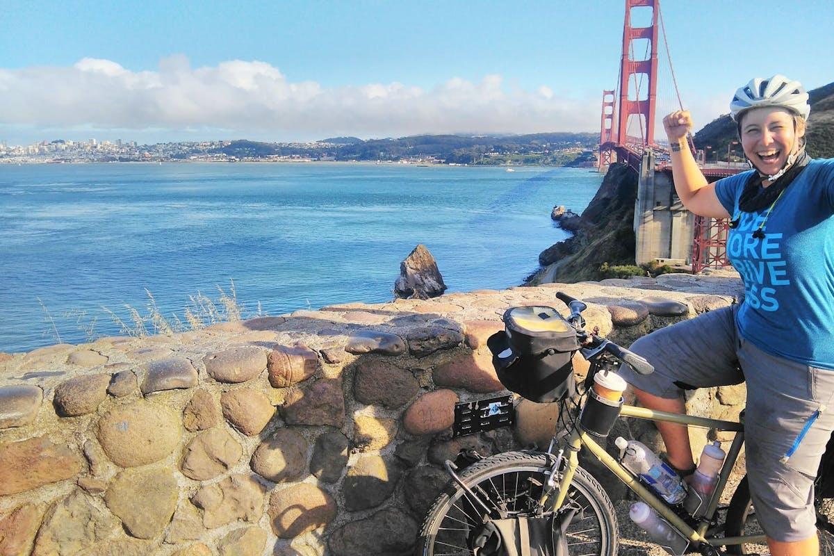 liz dodd on her bike in front of the golden gate bridge in san francisco