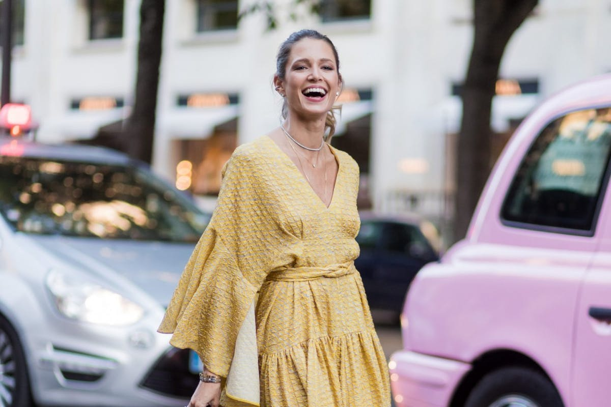 Street style wearing yellow dress