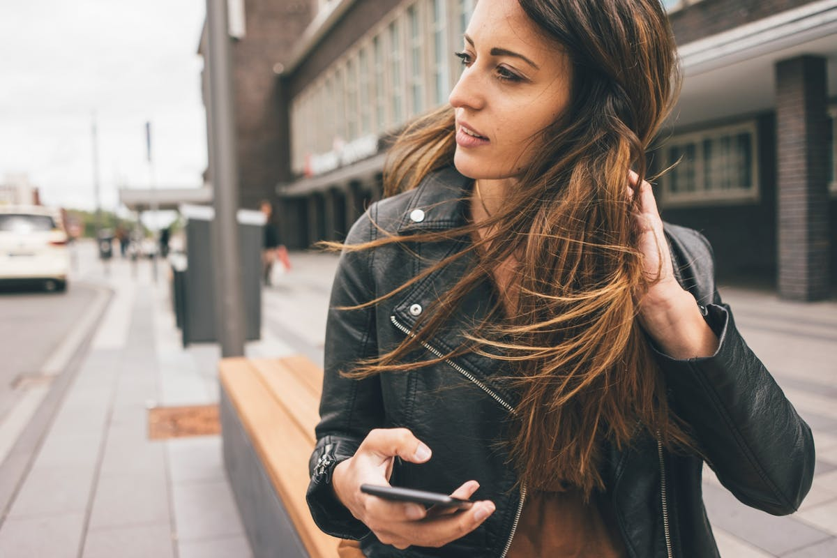 Girl on her phone staring into the distance