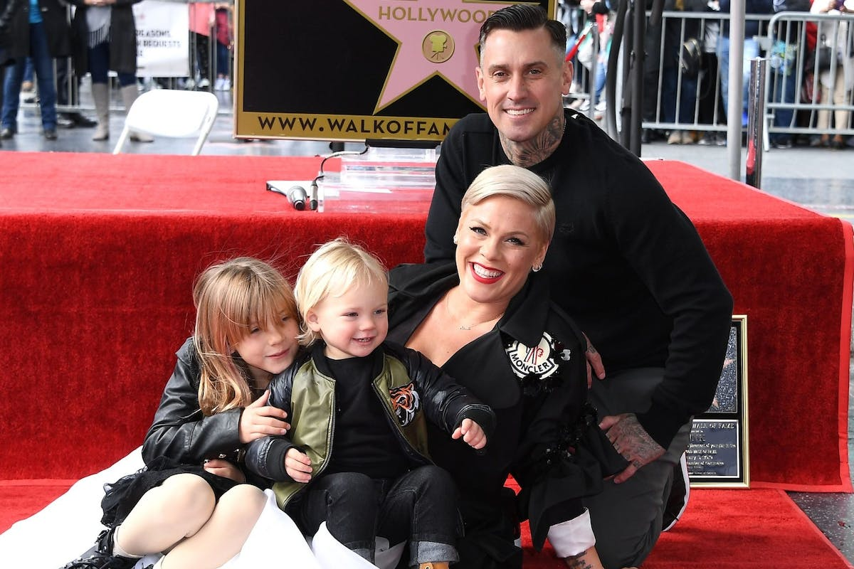 HOLLYWOOD, CALIFORNIA - FEBRUARY 05: Pink and Carey Hart pose as Pink is honored with a star on The Hollywood Walk Of Fame on February 05, 2019 in Hollywood, California. (Photo by Steve Granitz/WireImage)
