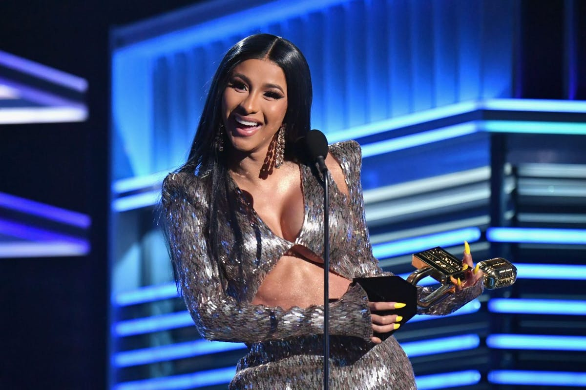 "LAS VEGAS, NV - MAY 01: Cardi B accepts the Top Rap Song award for ""I Like It"" onstage during the 2019 Billboard Music Awards at MGM Grand Garden Arena on May 1, 2019 in Las Vegas, Nevada. (Photo by Jeff Kravitz/FilmMagic for dcp)"