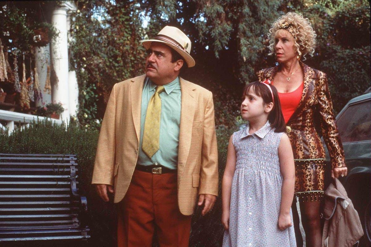 Mr and Mrs Wormwood and matilda in the Matilda movie