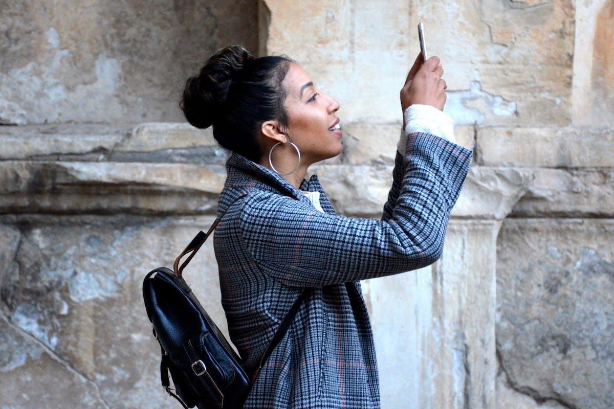 Woman takes Snapchat selfie