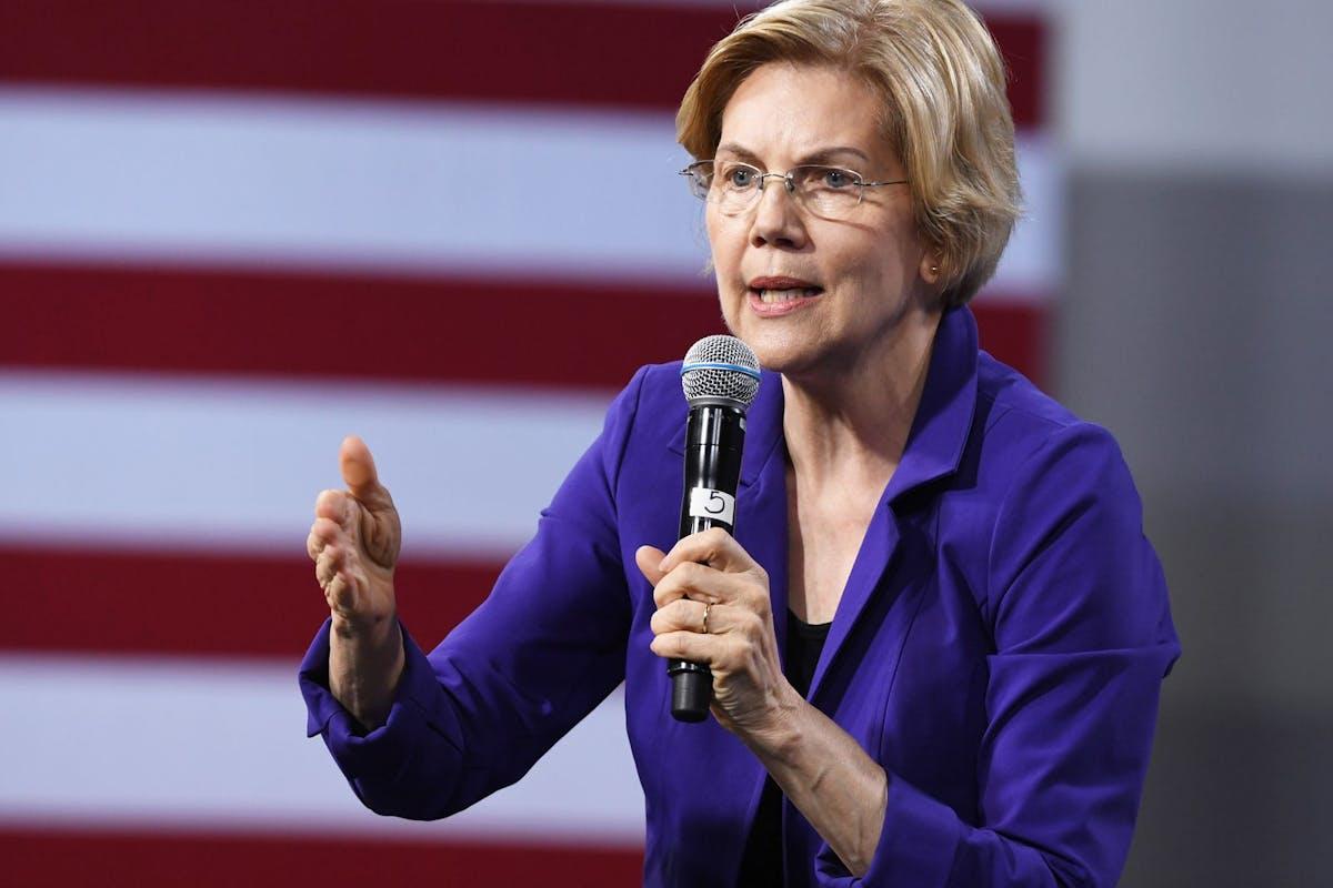 Elizabeth Warren during a speech in front of an American flag