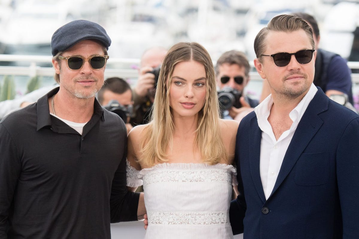 "CANNES, FRANCE - MAY 22: Brad Pitt, Margot Robbie and Leonardo DiCaprio attend the photocall for ""Once Upon A Time In Hollywood"" during the 72nd annual Cannes Film Festival on May 22, 2019 in Cannes, France. (Photo by Samir Hussein/WireImage)"