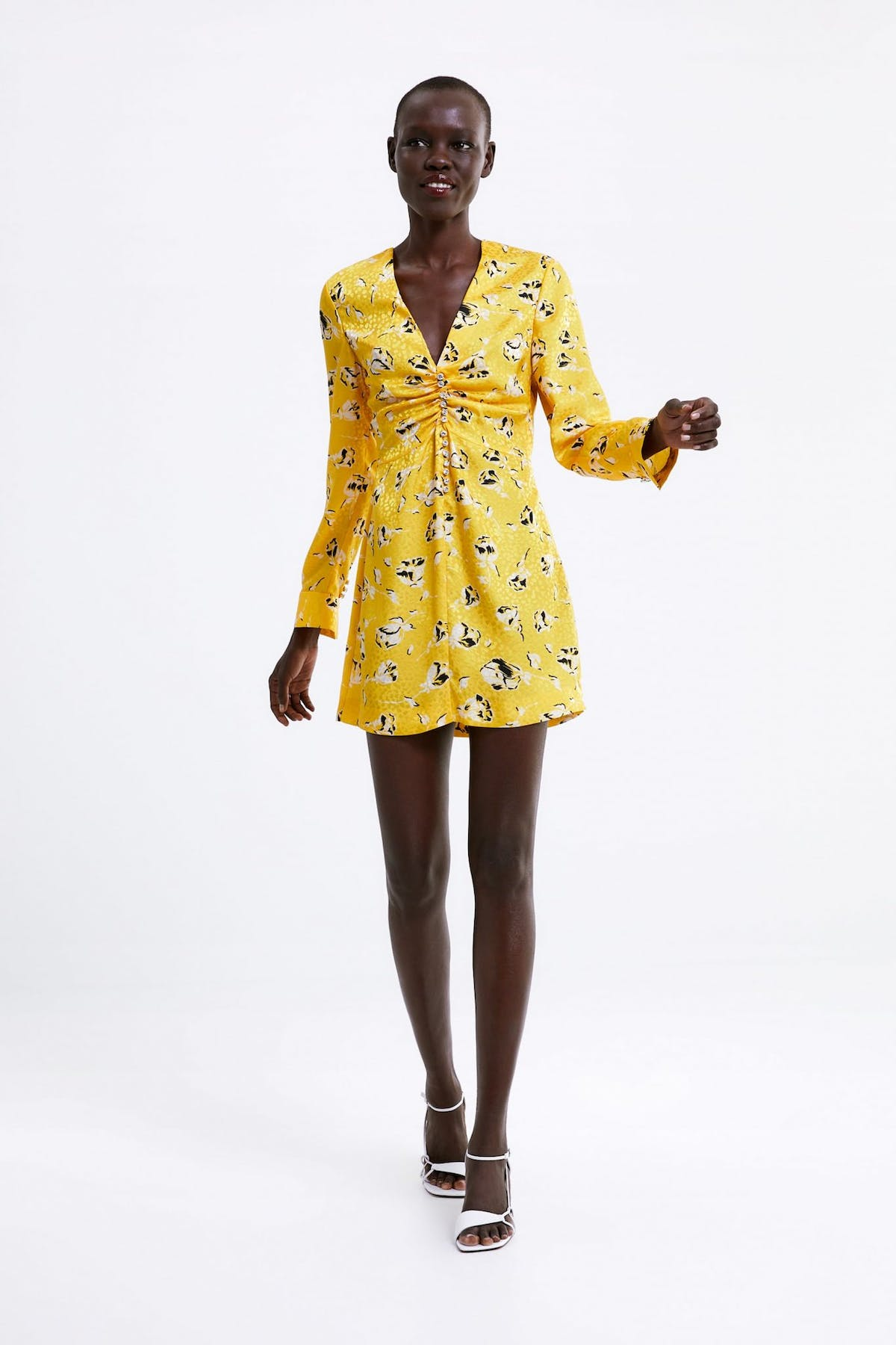 6c52bf26 The silky fabric, rhinestone buttons and luxe-looking print makes this mini  dress ...