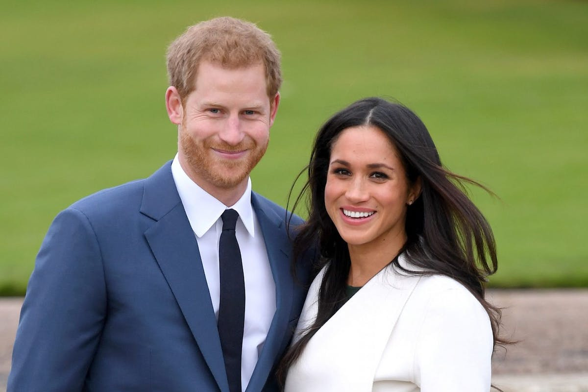 Prince Harry and Meghan Markle pose for photographers on the day they got engaged