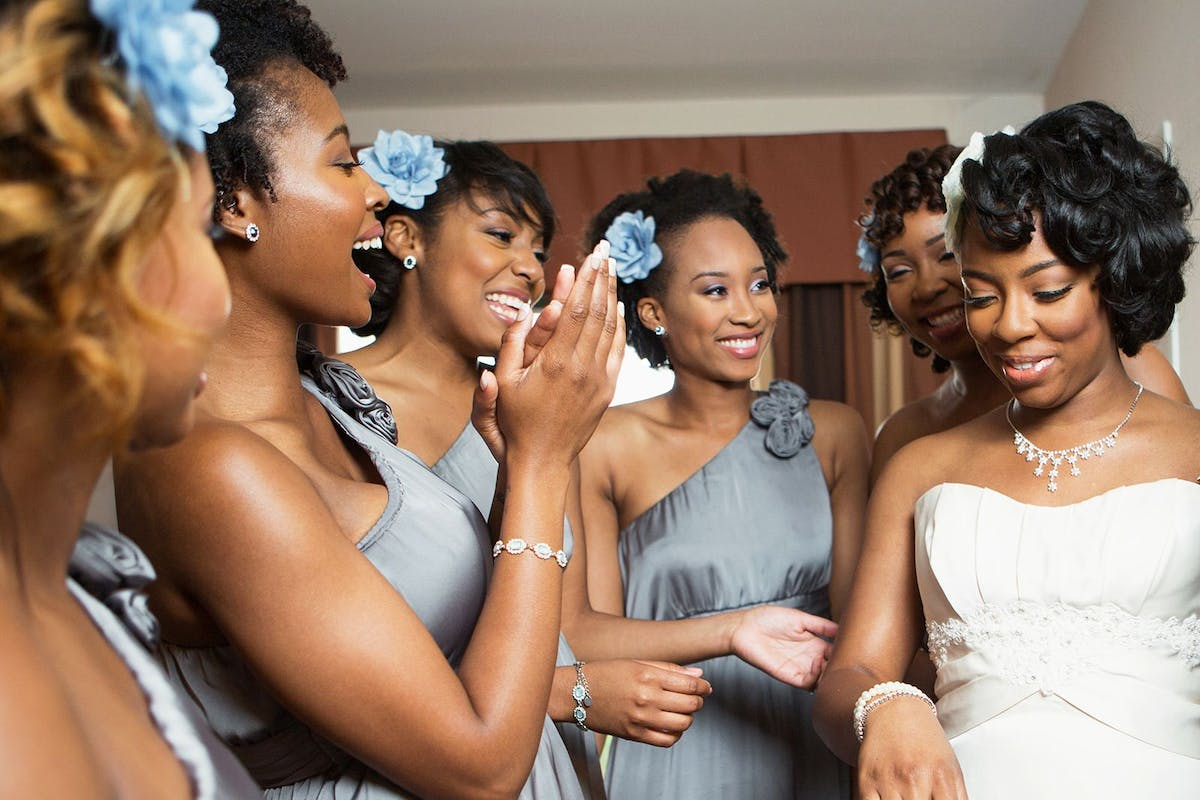 Bridesmaids celebrating a bride's wedding