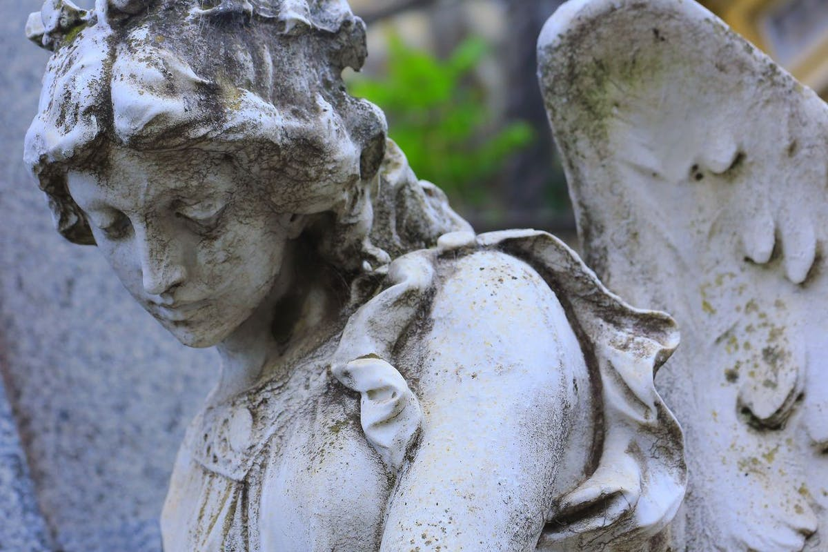 Young sad, beautiful fragile Madonna Angel, Recoleta cemetery, Buenos Aires