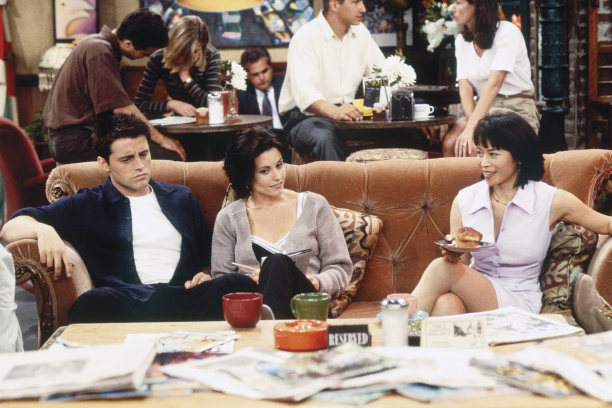 Shot from Friends picturing Joey, Monica and Julie on the sofa in Central Perk