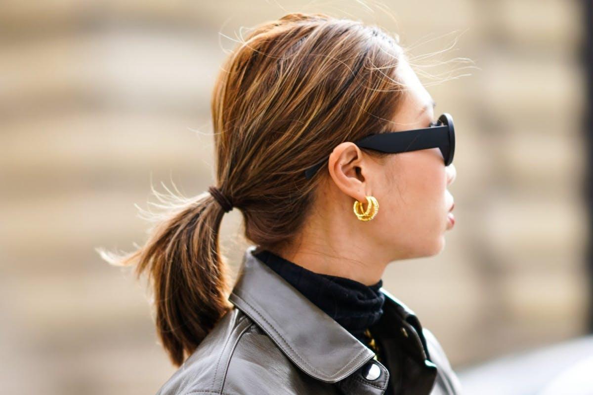 woman wearing gold hoop earrings