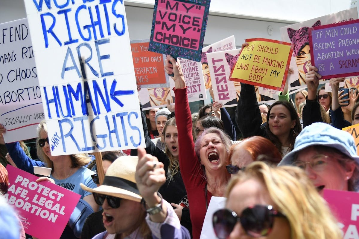 """Abortion rights advocates rally to protest new restrictions on abortions, May 21, 2019, in West Hollywood, California. - Demonstrations were planned across the US on Tuesday in defense of abortion rights, which activists see as increasingly under attack. The """"Day of Action"""" rallies come after the state of Alabama passed the country's most restrictive abortion ban, prohibiting the procedure in all cases, even rape and incest, unless the mother's life is at risk. Alabama is among about 14 states which have adopted laws banning or drastically restricting access to abortion, according to activists. (Photo by Robyn Beck / AFP) (Photo credit should read ROBYN BECK/AFP/Getty Images)"""