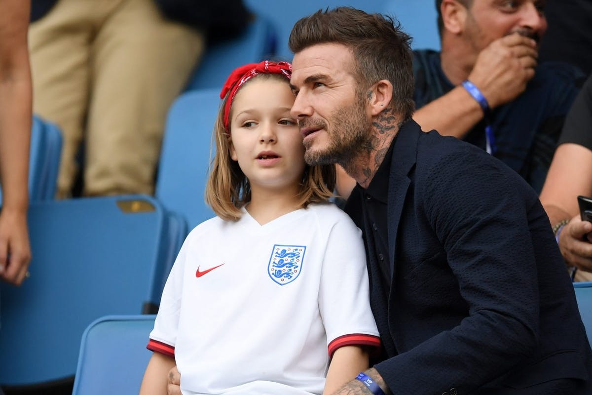 LE HAVRE, FRANCE - JUNE 27: David Beckham is seen in the stands with his daughter, Harper, prior to the 2019 FIFA Women's World Cup France Quarter Final match between Norway and England at Stade Oceane on June 27, 2019 in Le Havre, France. (Photo by Alex Caparros - FIFA/FIFA via Getty Images)