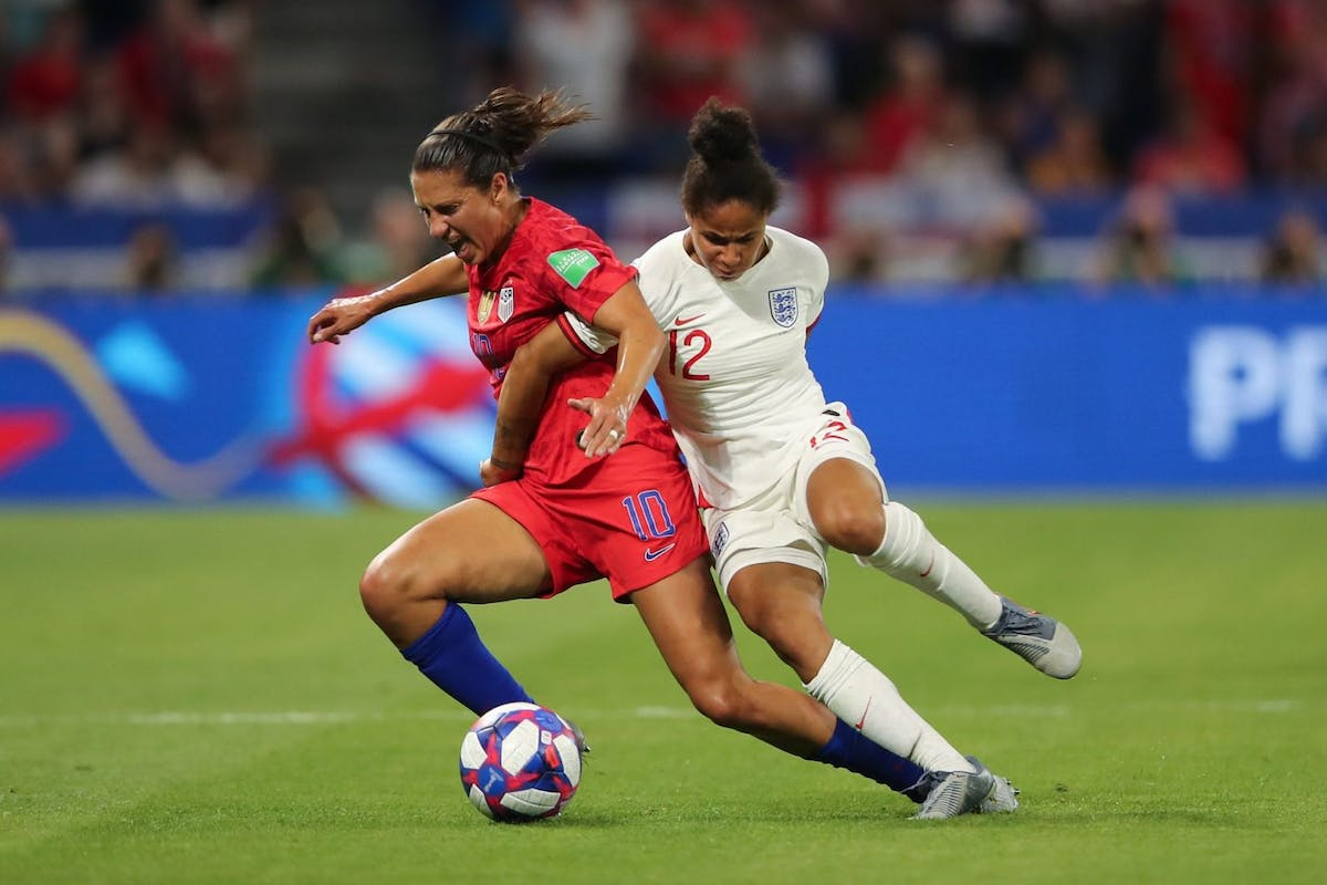 LYON, FRANCE - JULY 02: Carli Lloyd of USA and Demi Stokes of England during the 2019 FIFA Women's World Cup France Semi Final match between England and United States of America at Stade de Lyon on July 2, 2019 in Lyon, France. (Photo by Molly Darlington - AMA/Getty Images)