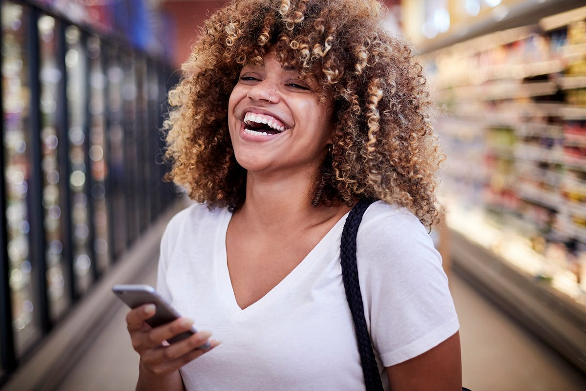 Woman laughing on phone
