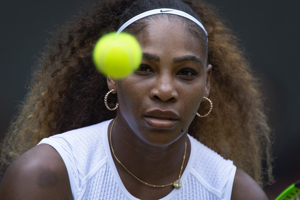Serena Williams playing tennis at Wimbledon