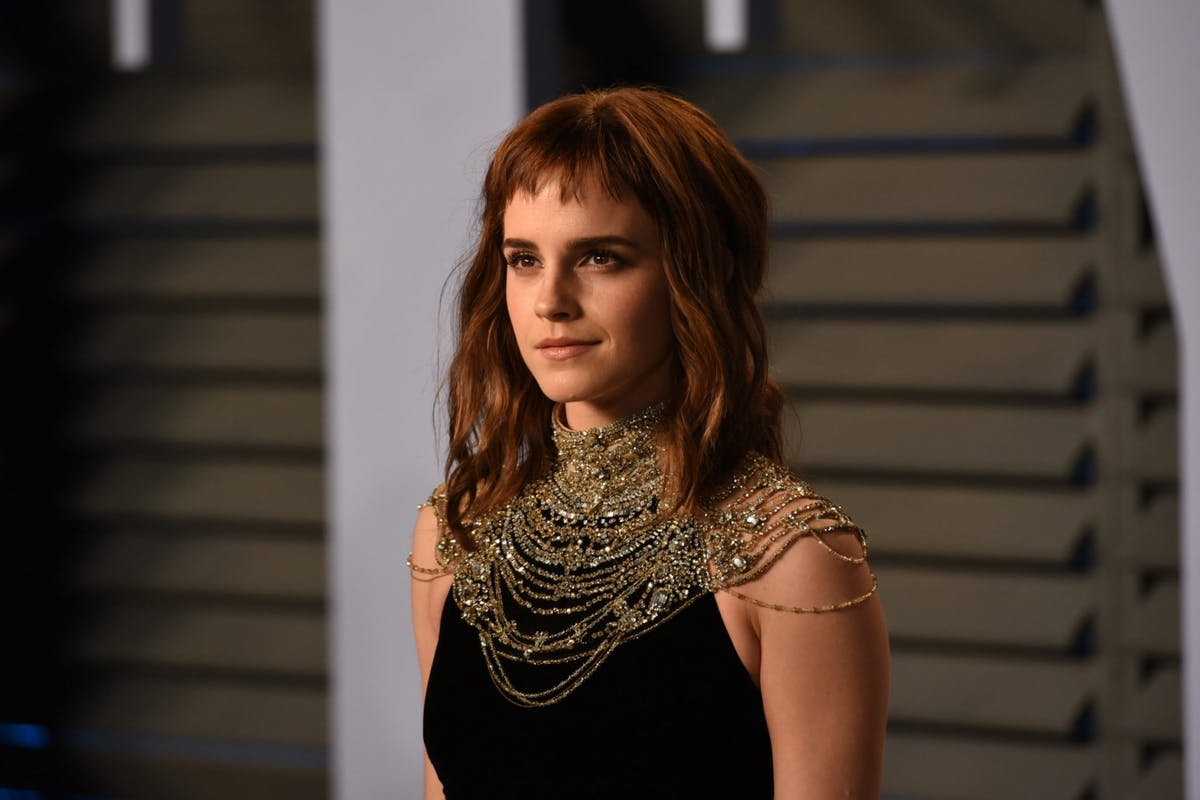 Emma Watson on the red carpet at the 2018 Vanity Fair Oscars party