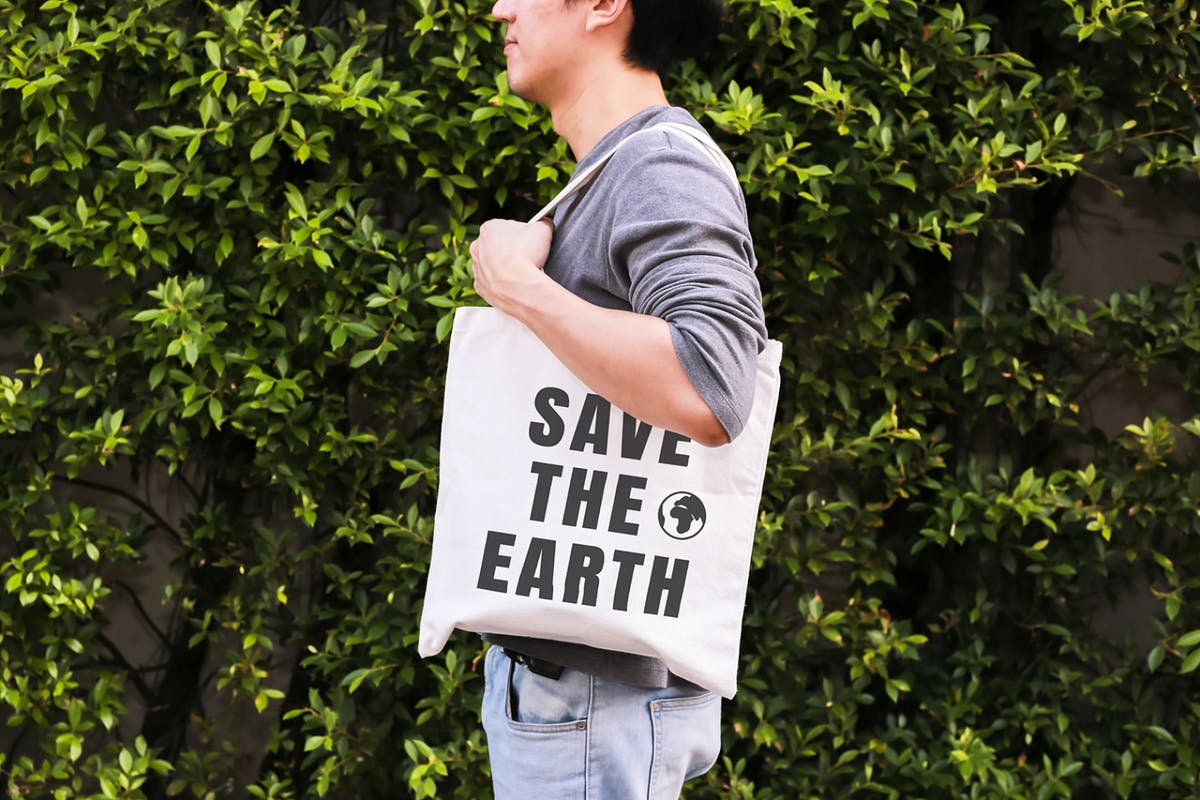 Man carrying reusable tote bag