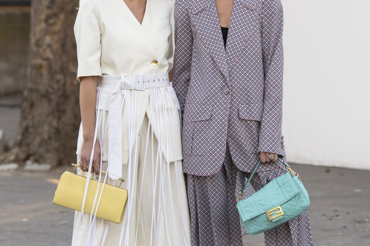 Street style image of baguette bags