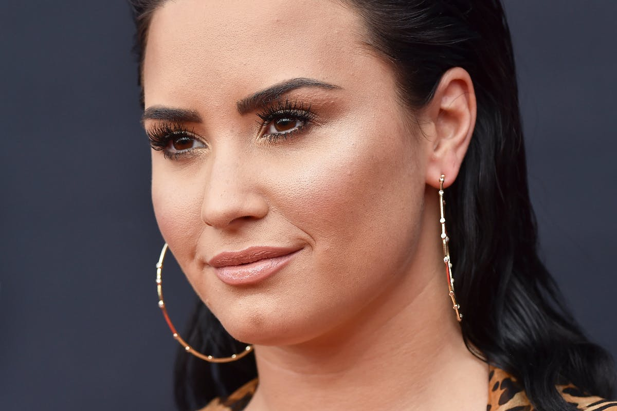 Demi Lovato defies body shamers – and embraces her cellulite – with powerful bikini photo