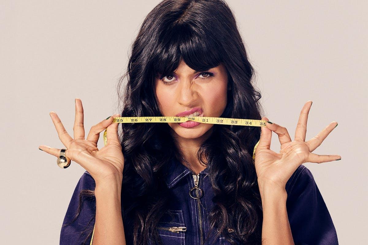 Jameela Jamil with a tape measure between her teeth, symbolising the diet industry