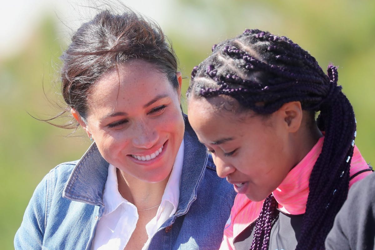 Meghan Markle with Waves for Change charity representative