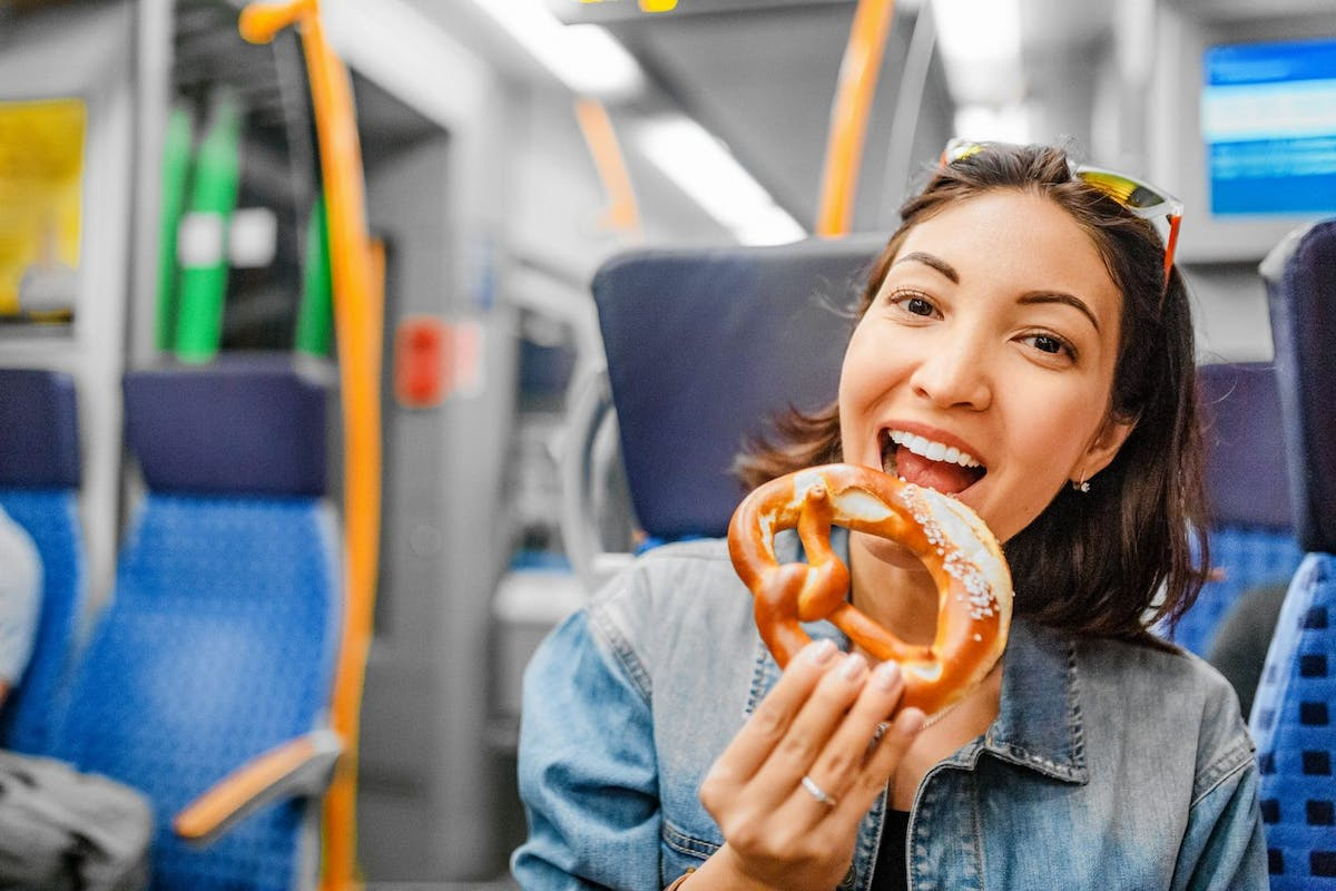 Woman eating on train