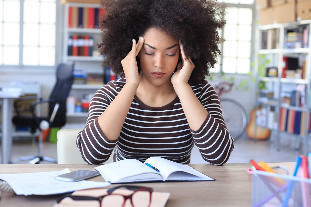 A woman at work looking stressed